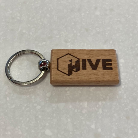 Wooden keychain with laser engraved HIVE logo
