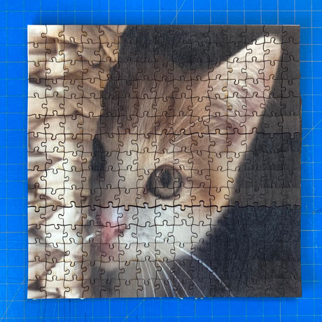 Laser cut jigsaw puzzle with UV printed image of kitten